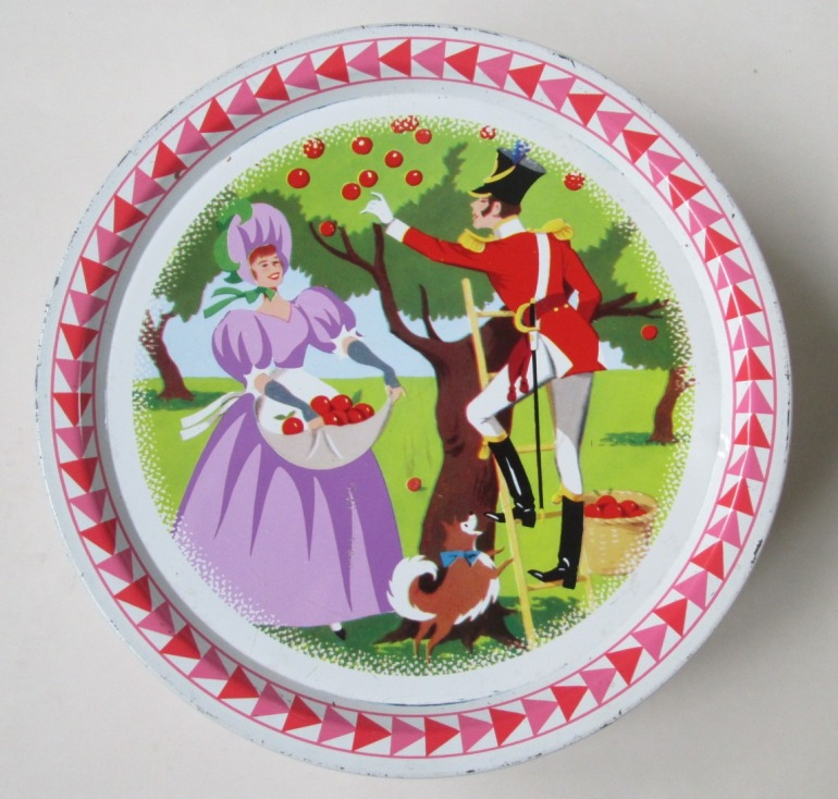 The Quality Street Soldier & Lady pick apples in the orchard