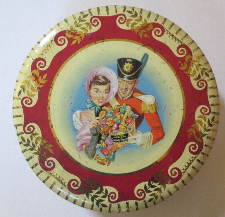 The Soldier & Lady with an overflowing tin of Quality Street