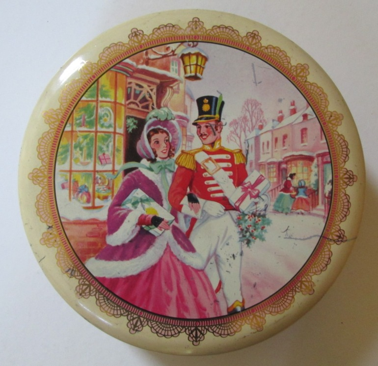 A classic 1950s Christmas image of the Quality Street Soldier & Lady