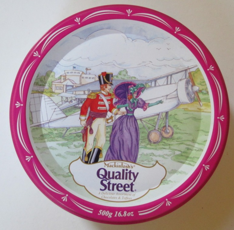 The Quality Street Soldier & Lady by a WW1 biplane
