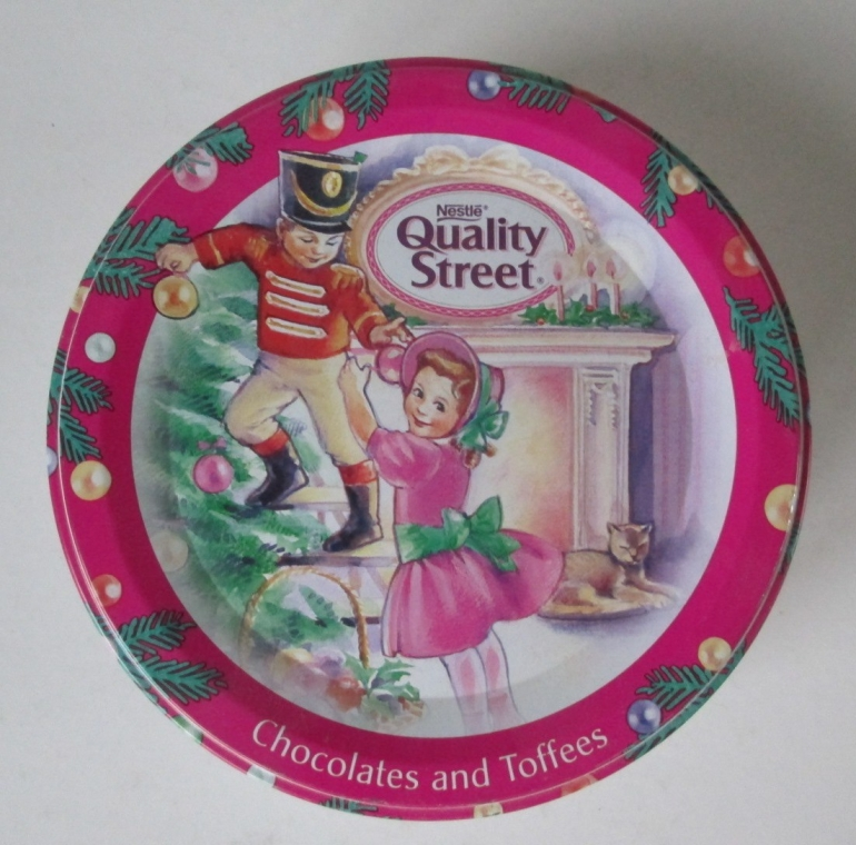 The Quality Street Soldier & Lady children decorate the Christmas tree