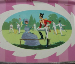 The Quality Street Soldier & Lady watch a cricket match