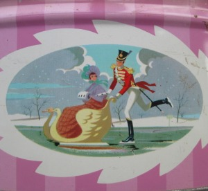 The Quality Street Soldier pushes the Lady in a sleigh