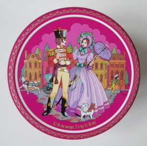 The Quality Street Soldier & Lady under a lilac sky
