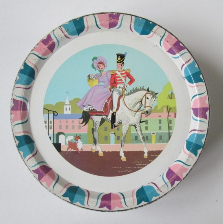 The Quality Street Lady rides sidesaddle on a horse with the Soldier