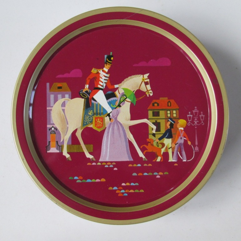 The Quality Street Soldier & Lady ina maroon setting