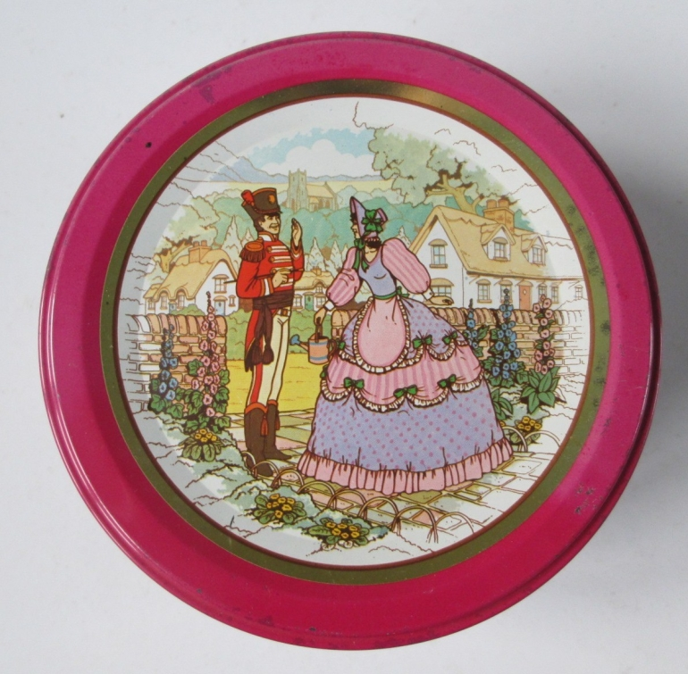 The Quality Street Soldier & Lady meet in a garden