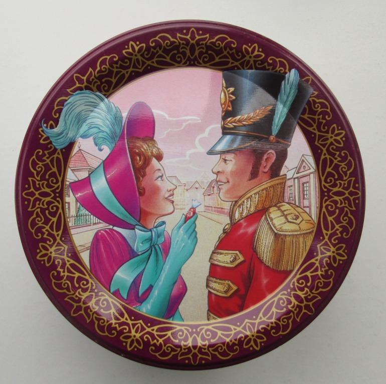 The Quality Street Lady in a striking purple bonnet