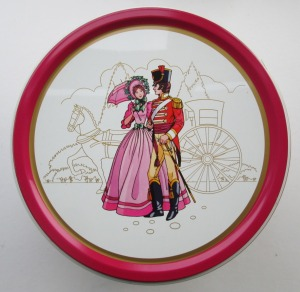 The Quality Street Soldier & Lady against a silhouette carriage
